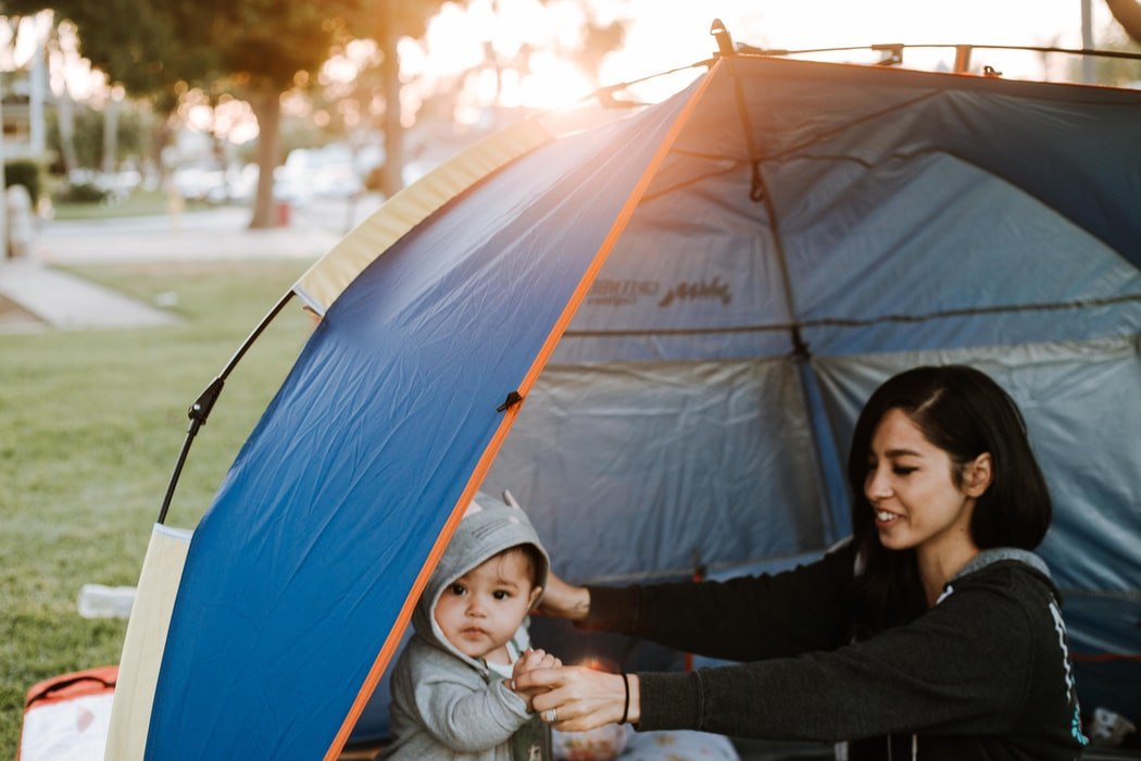 woman and baby in tent