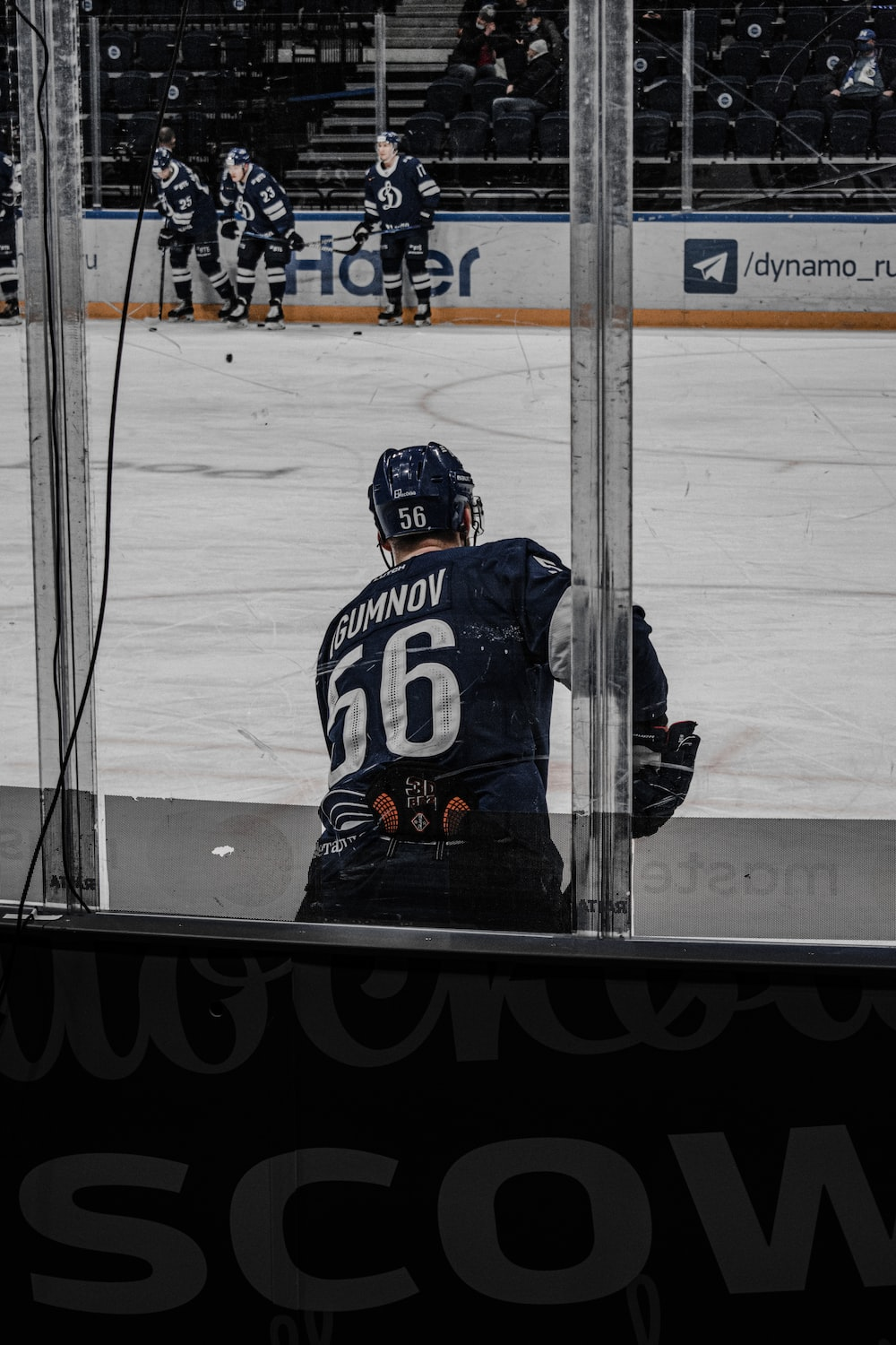 man in blue and white ice hockey jersey