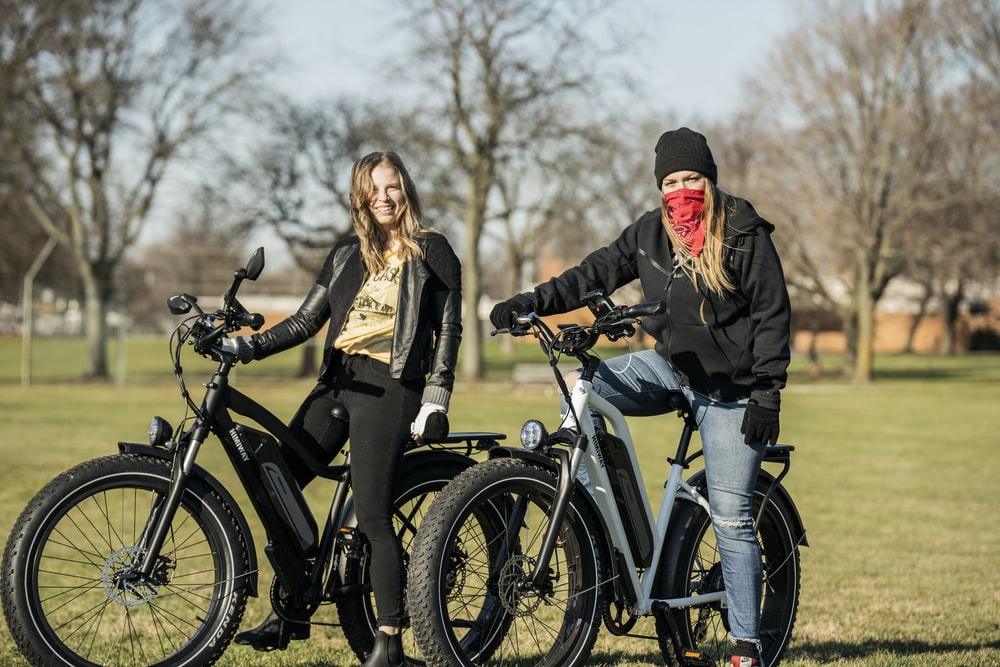 man and woman riding on bicycle during daytime