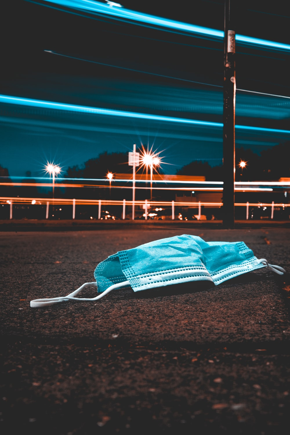 blue umbrella on gray sand during night time