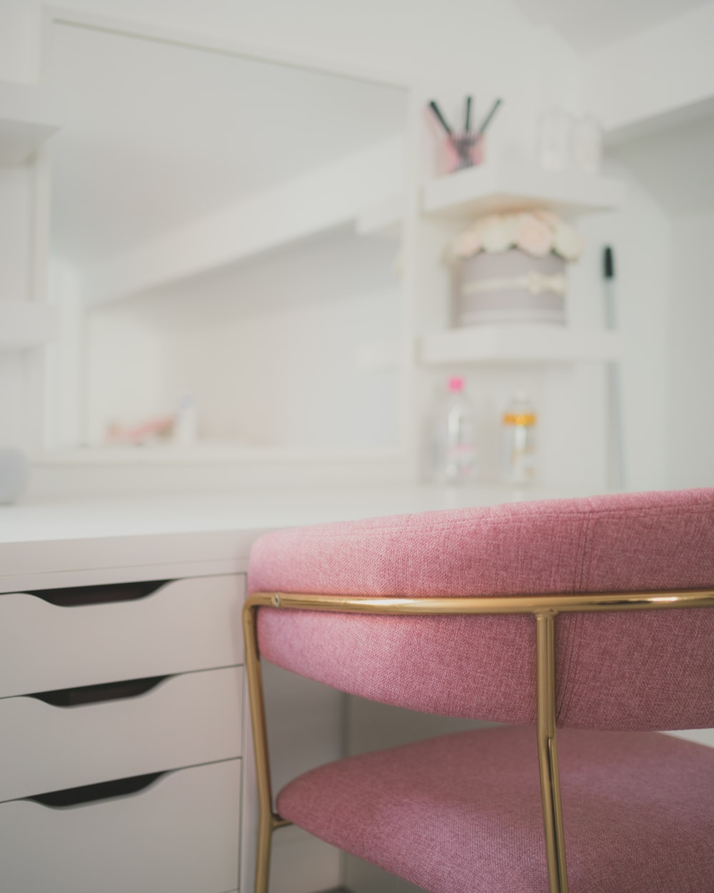 white wooden drawer with pink cushion