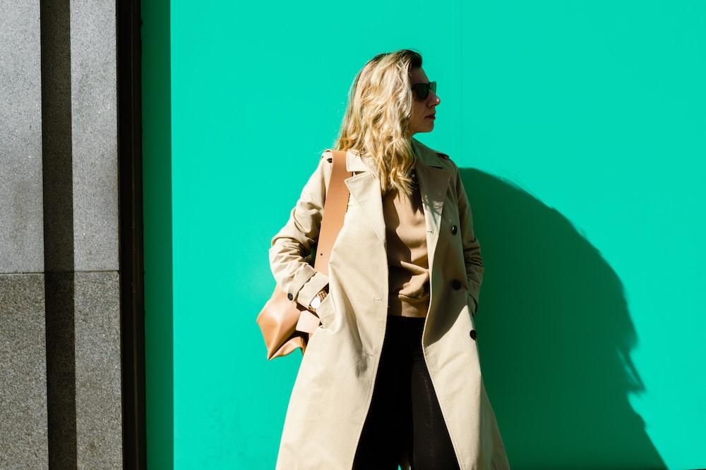 woman in beige coat standing