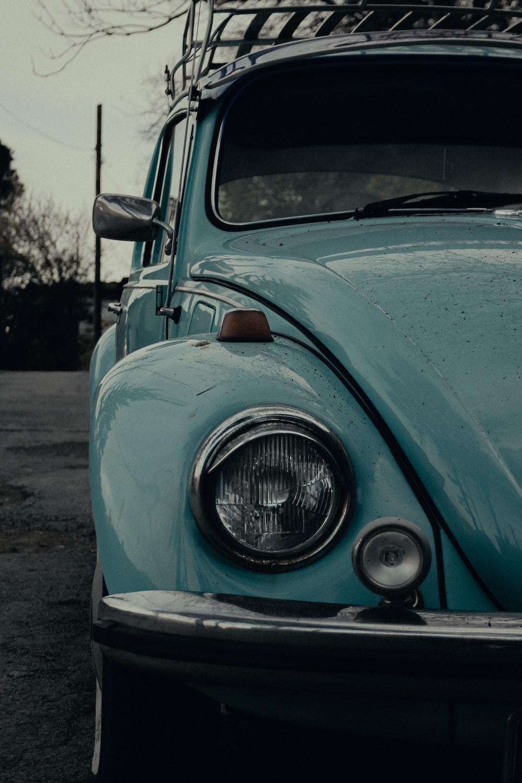 blue car on gray asphalt road during daytime