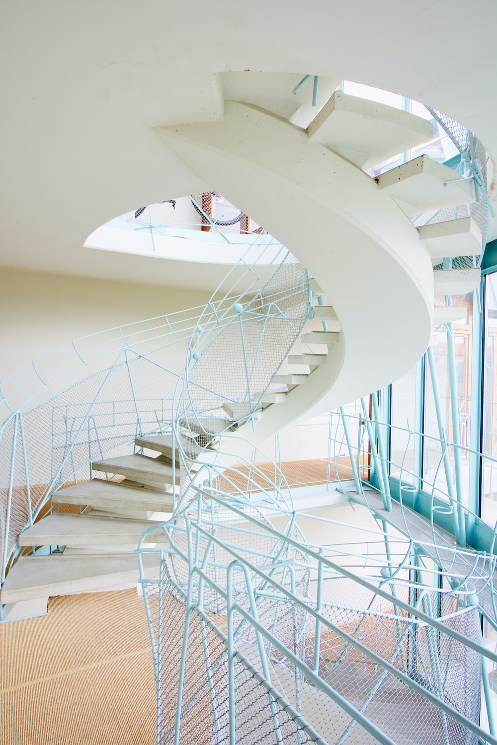 white spiral staircase with white railings