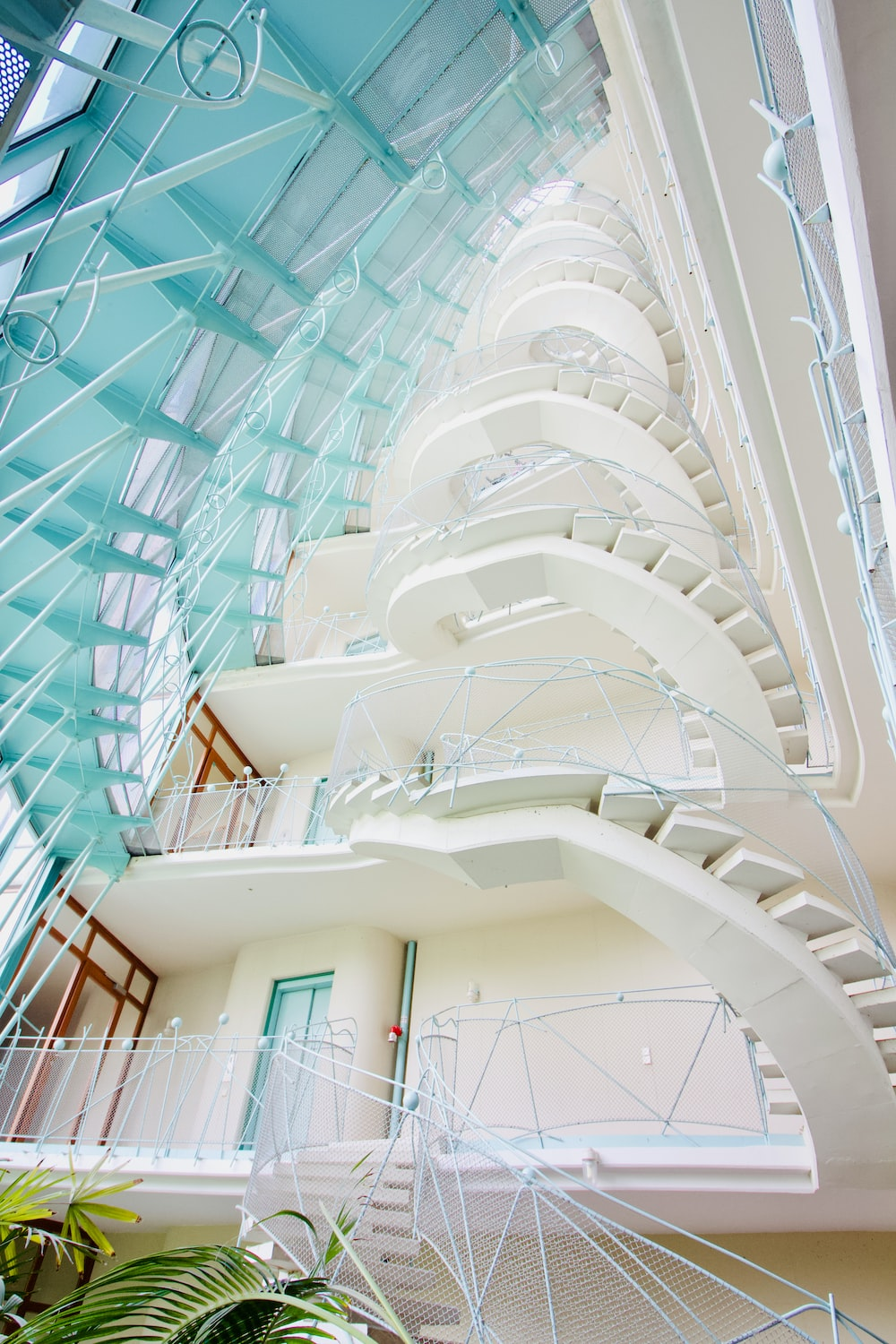 white concrete building with glass roof