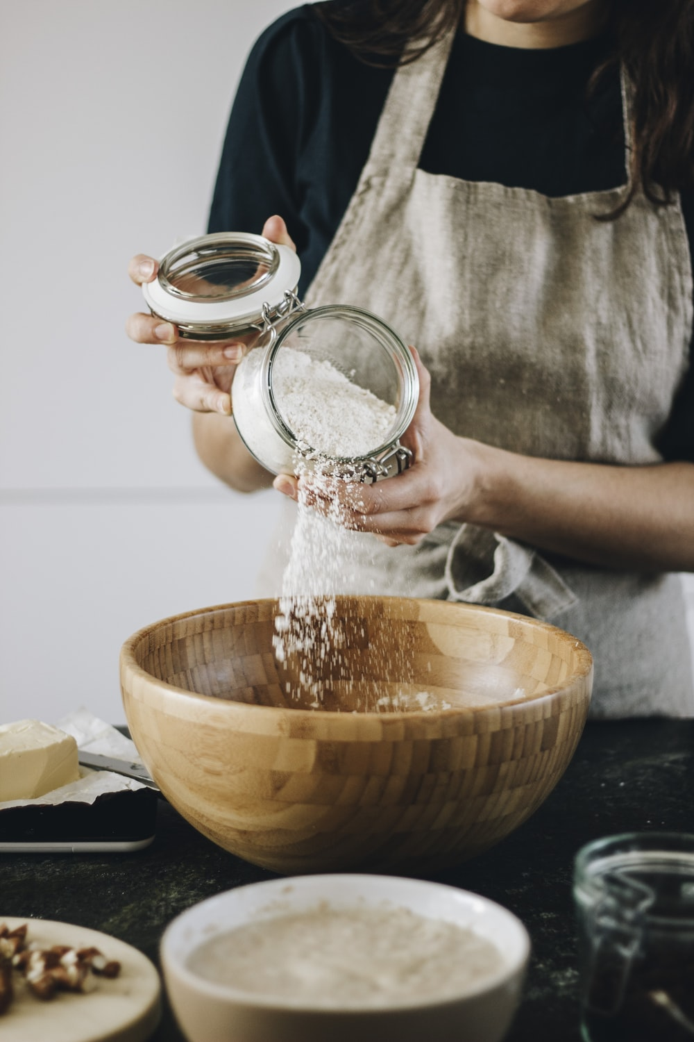 person pouring water on brown bowl