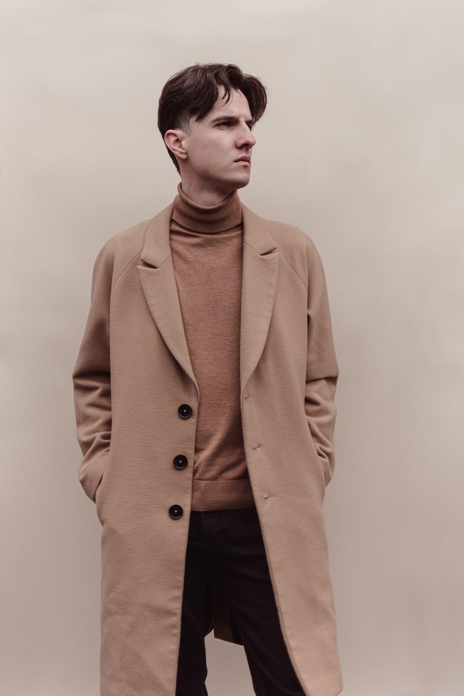 man in brown coat and black pants