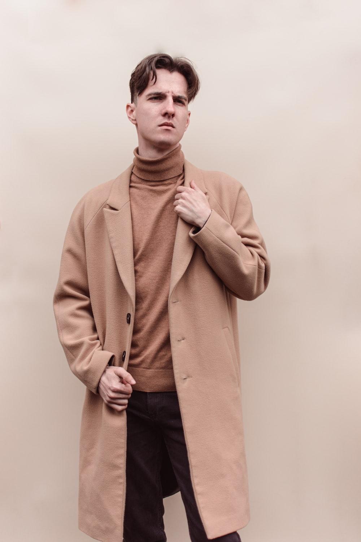 man in brown coat standing