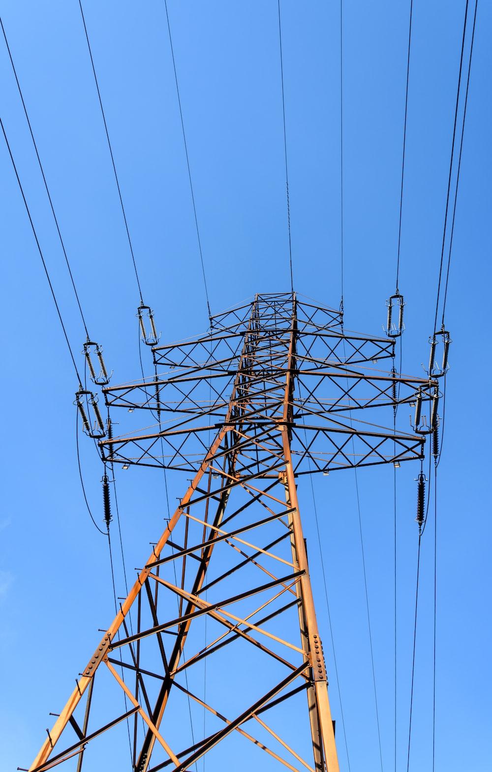 brown metal tower under blue sky during daytime