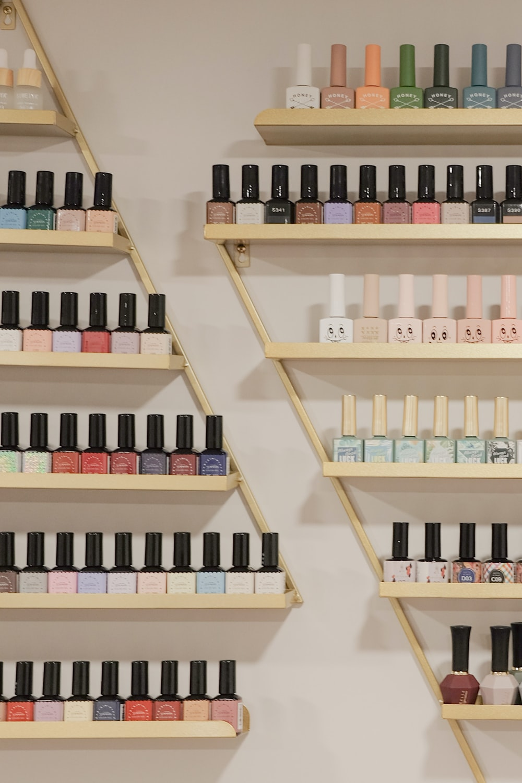 white and black bottles on brown wooden shelf