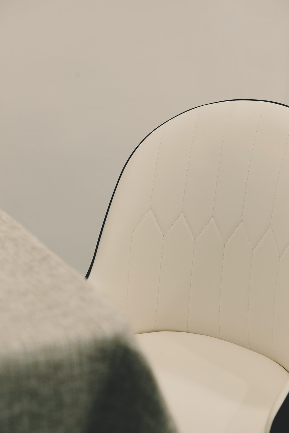 white and gray striped chair