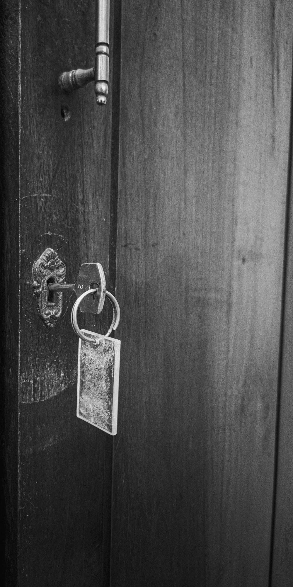 gray padlock on wooden door