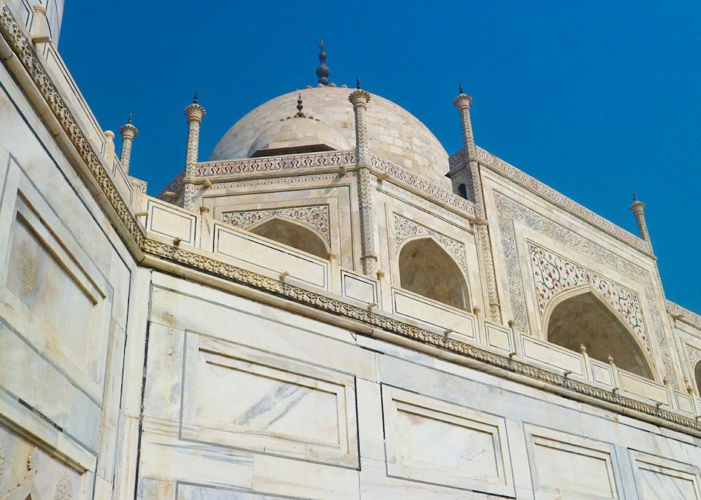 beige concrete building under blue sky during daytime