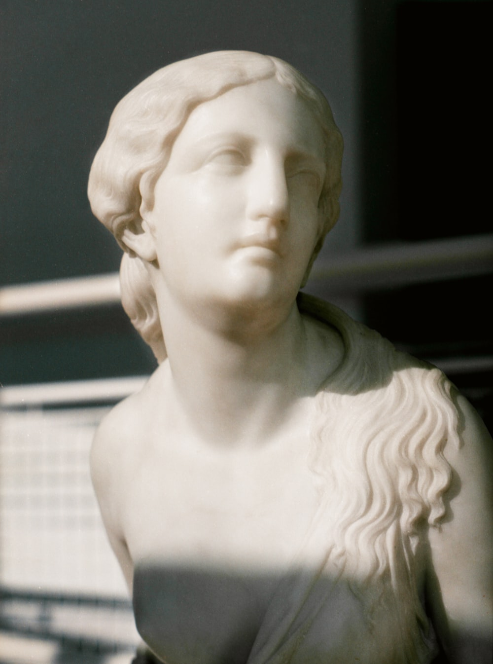 white ceramic bust of a woman