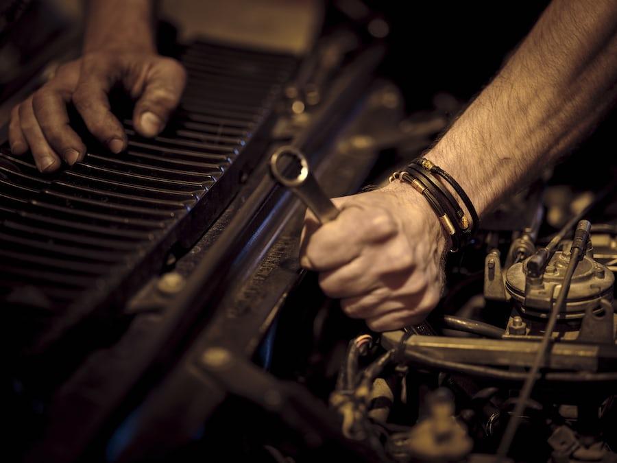 mechanic removing a bolt