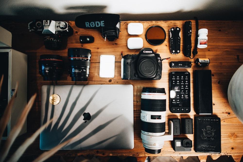 black dslr camera on brown wooden table