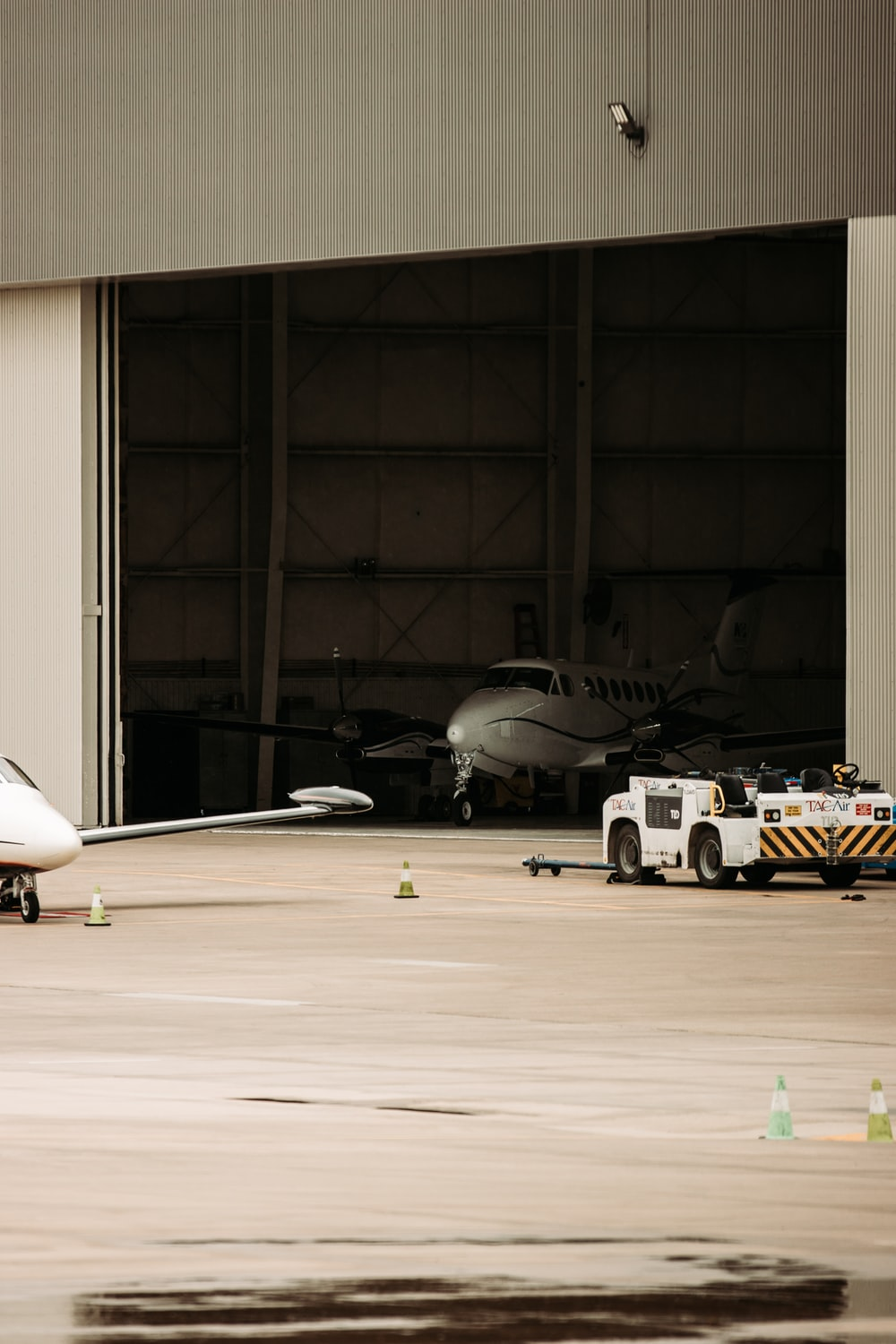 white airplane on a airport