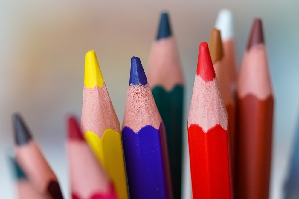close up photography of color pencils