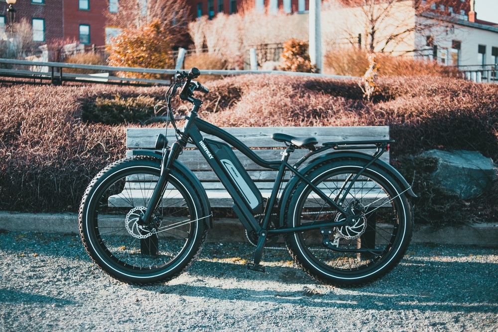 black commuter bike on snow covered ground during daytime