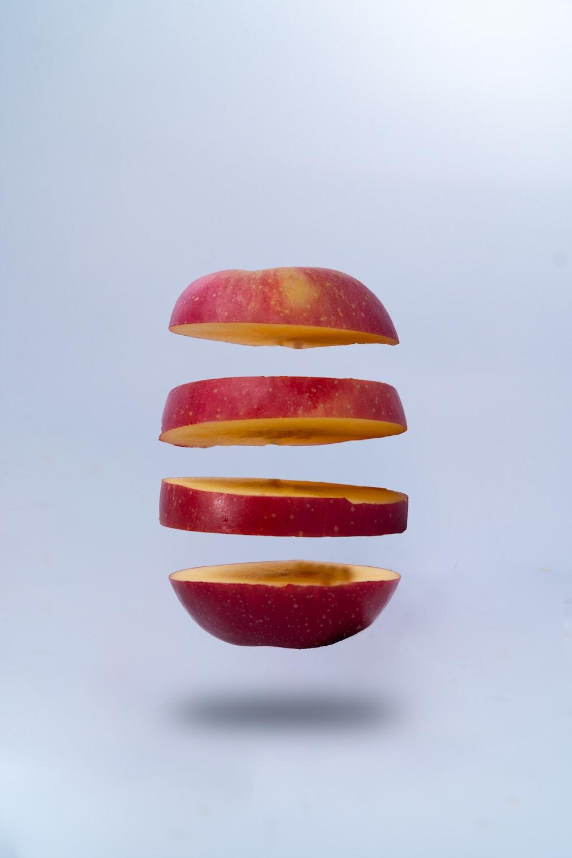 sliced orange fruit on white surface