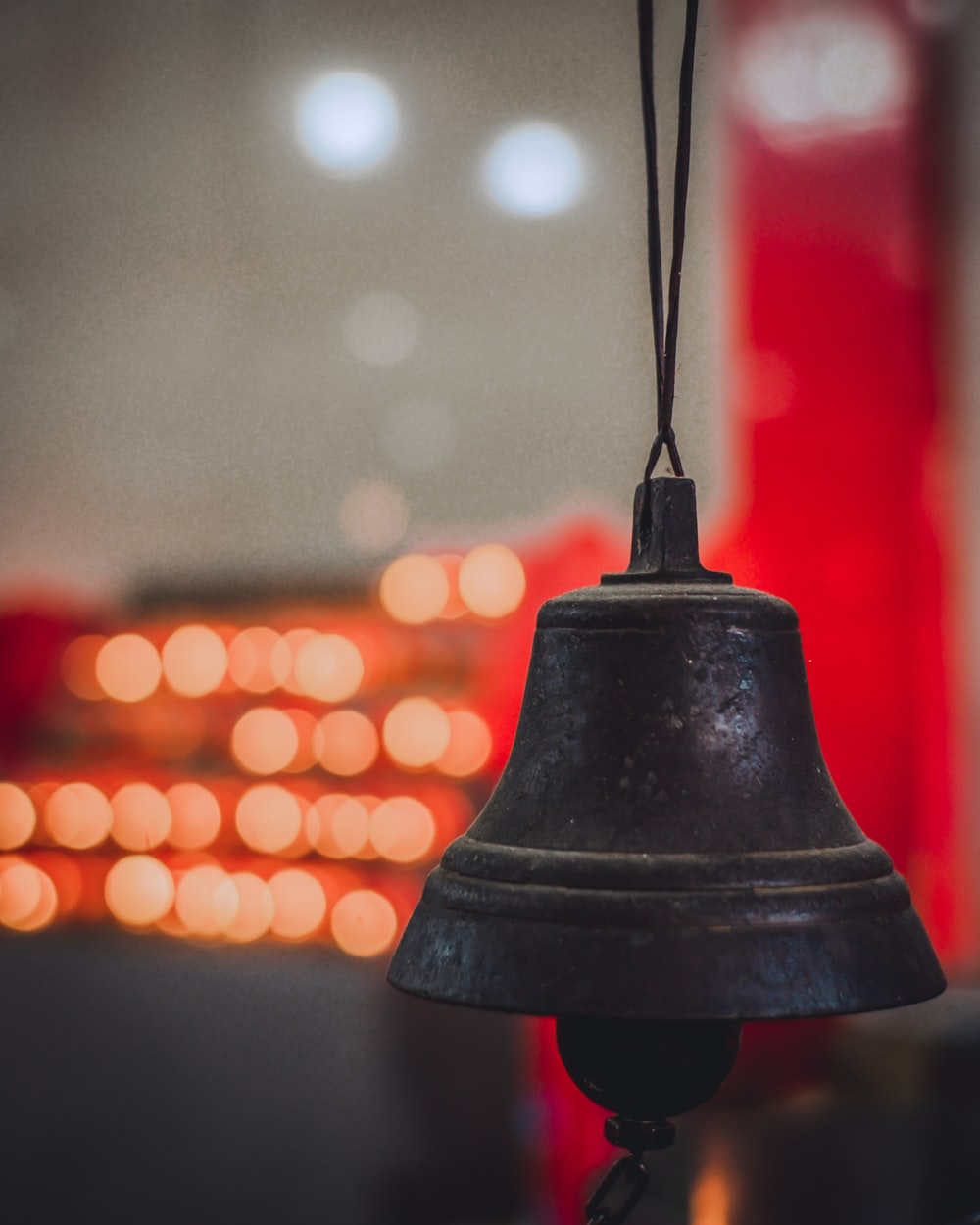 black bell with bokeh lights