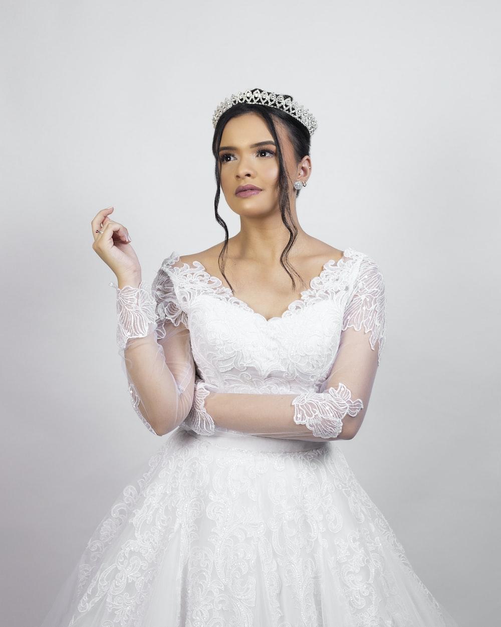woman in white floral dress wearing white floral tiara