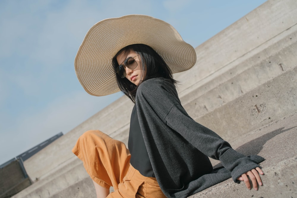 woman in black long sleeve shirt and brown sun hat