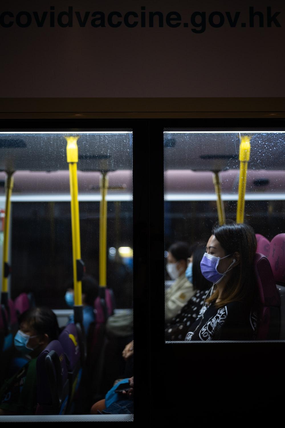 people sitting on train during daytime