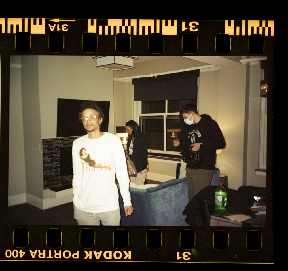 man in white dress shirt standing beside man in black crew neck t-shirt
