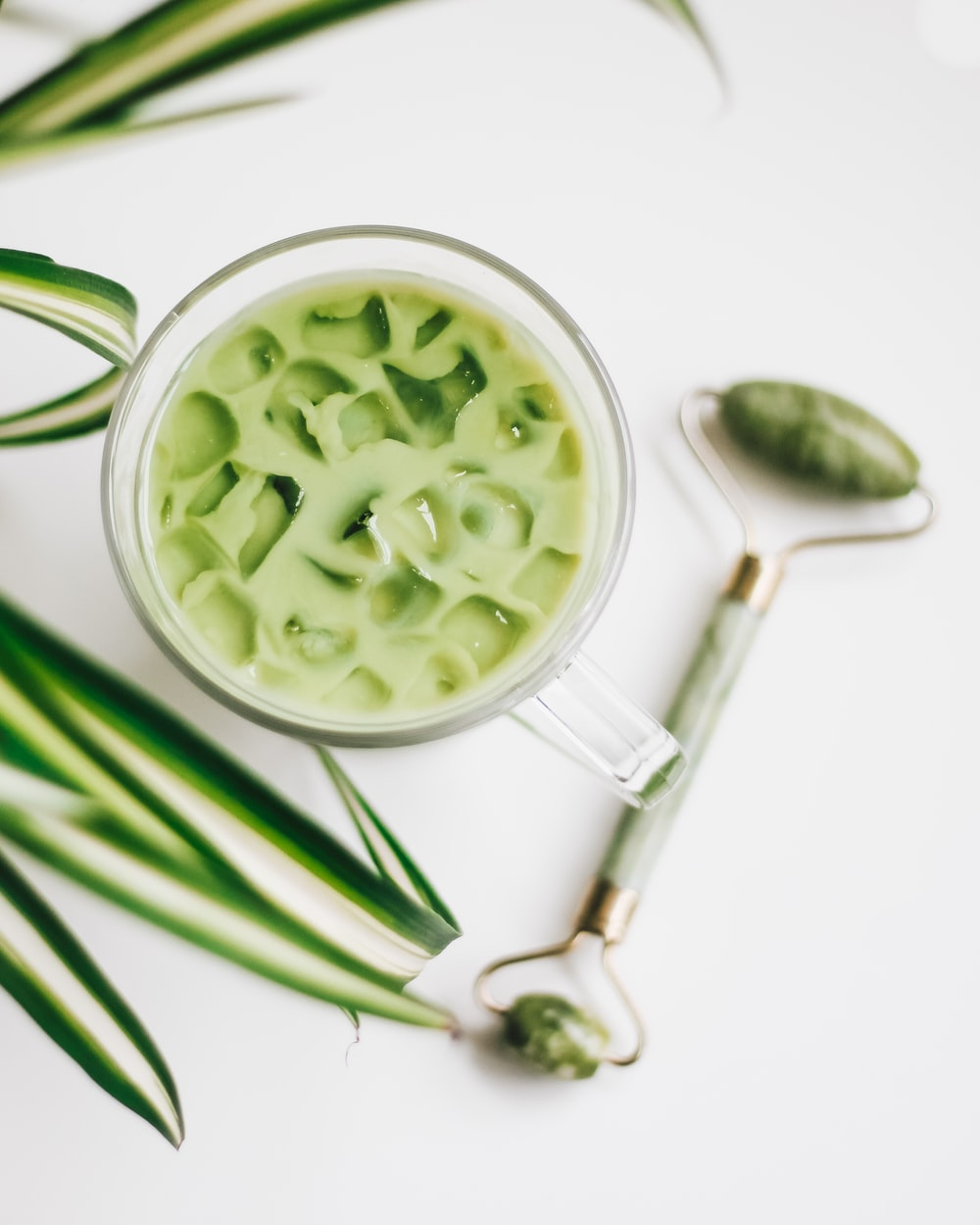 green and white ceramic bowl with green liquid