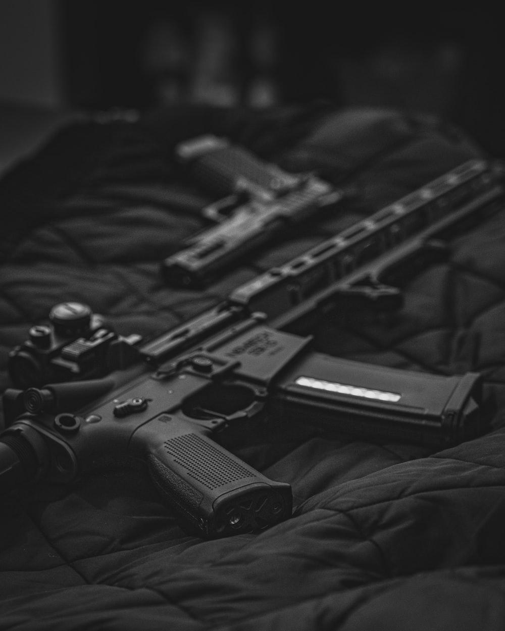 black semi automatic pistol on black textile