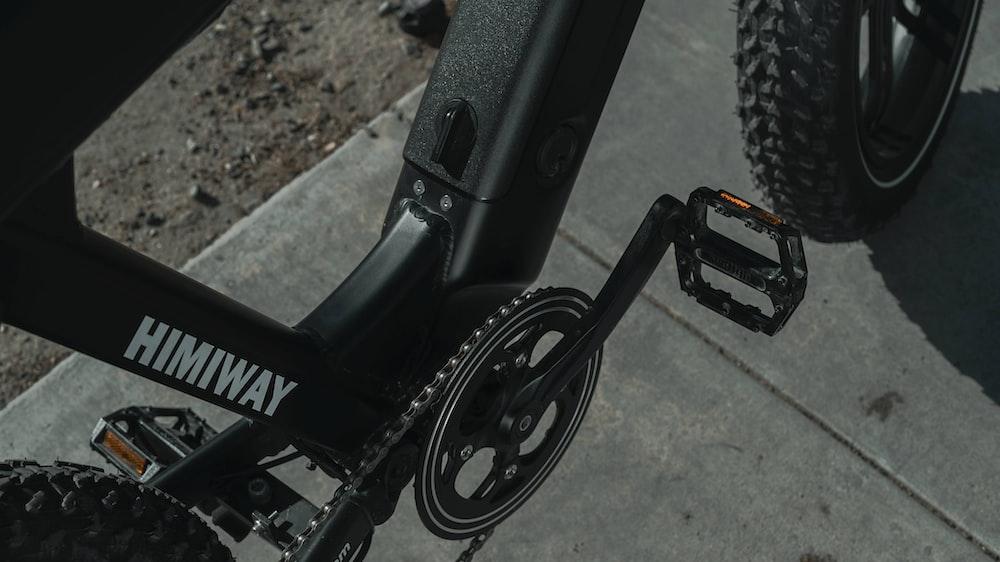 black bicycle on brown soil