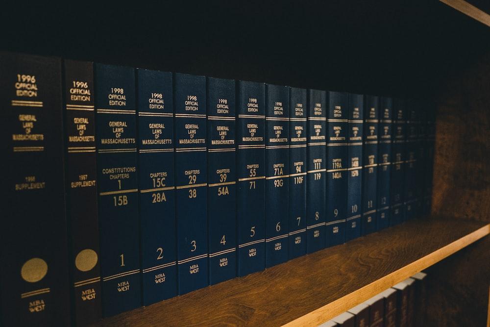 blue locker on brown wooden shelf