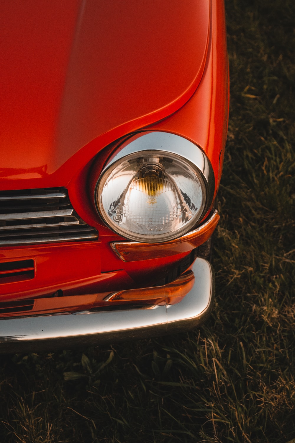 red car on brown grass