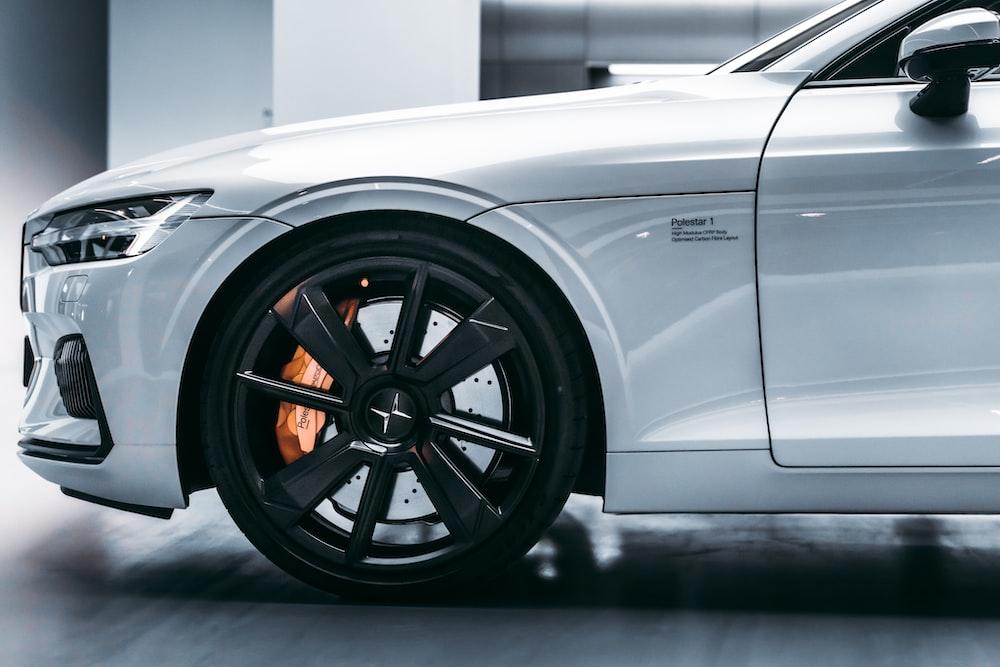 white car with black wheel