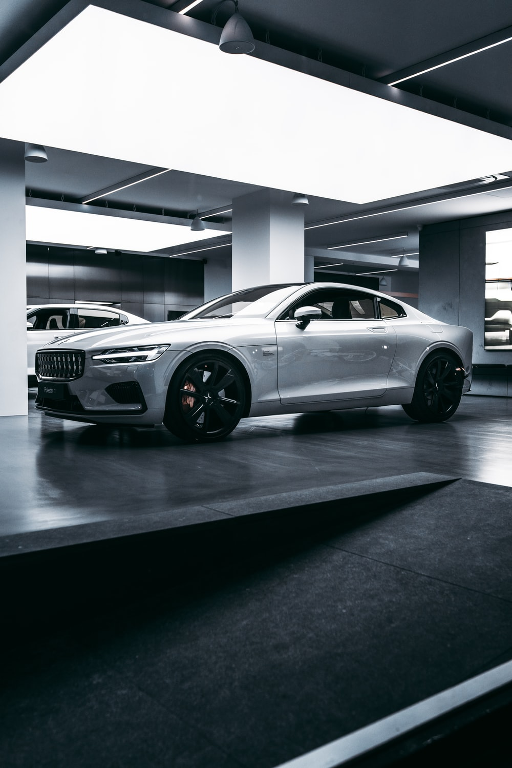 silver bmw m 3 coupe parked in building