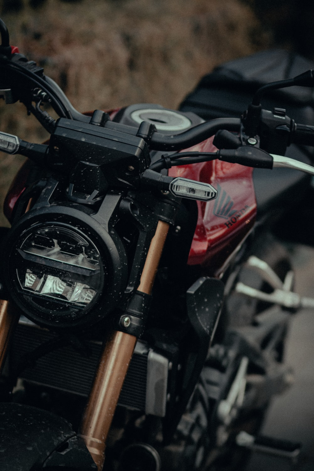 black and red motorcycle in close up photography