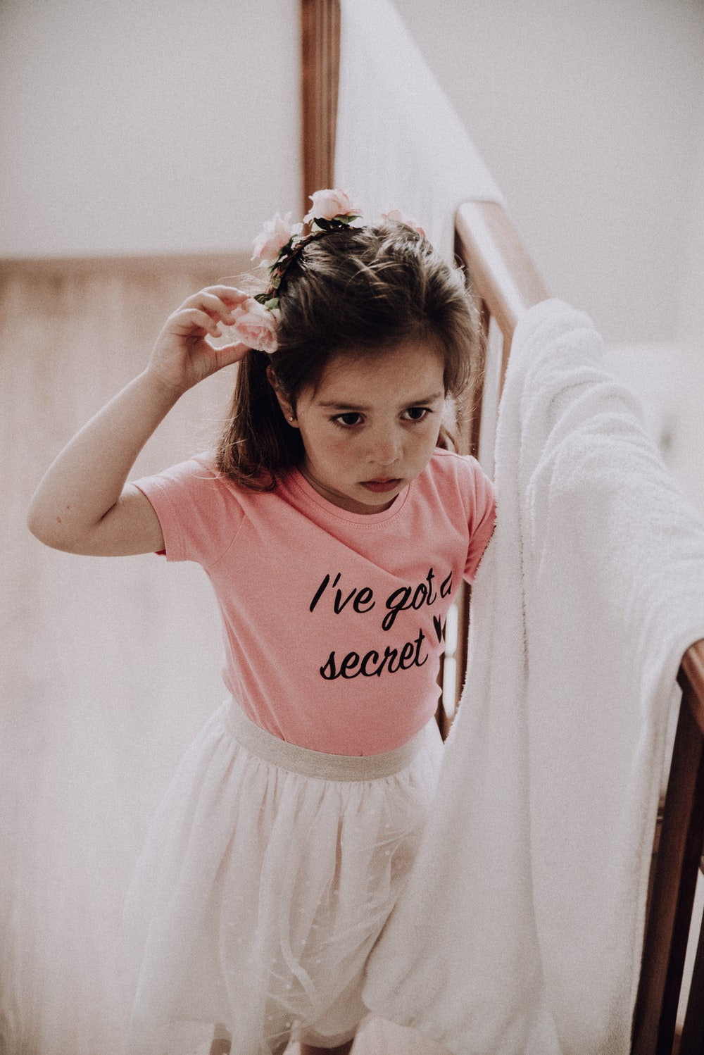 girl in pink and white crew neck t-shirt and white skirt