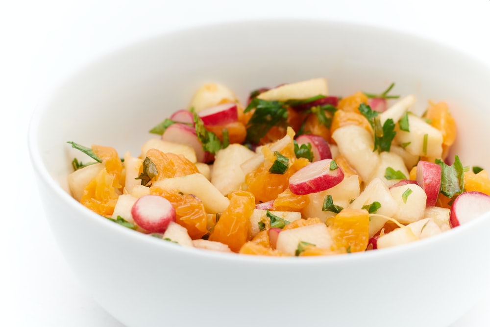 sliced vegetables in white ceramic bowl