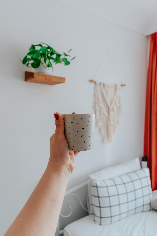 white and black polka dot ceramic mug