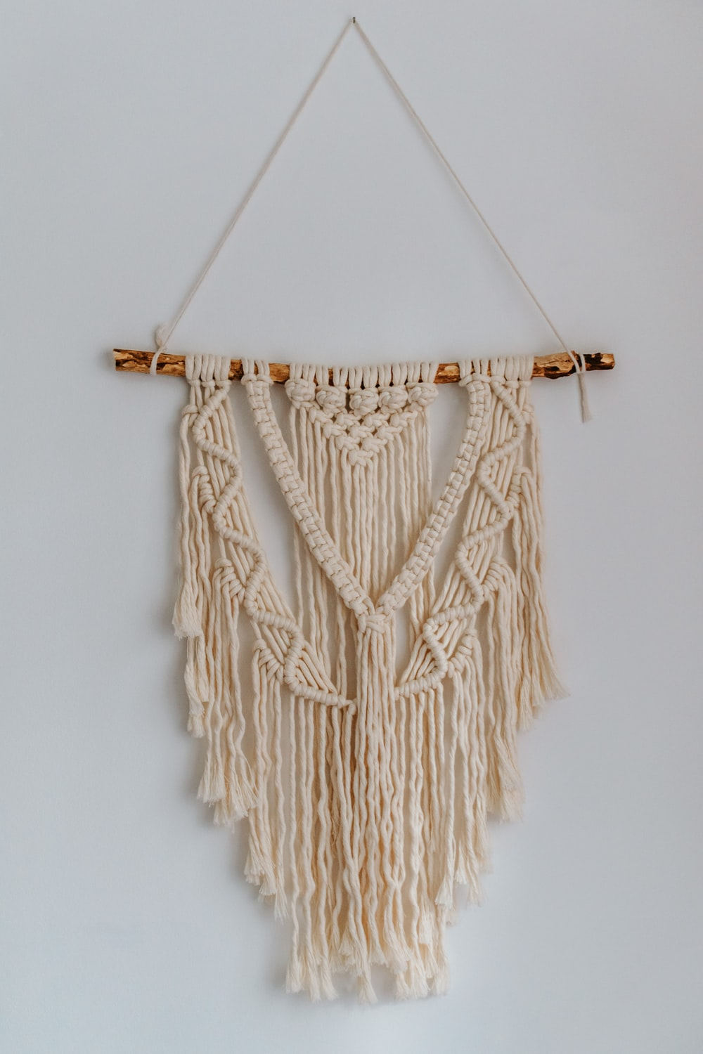 brown rope on white wall