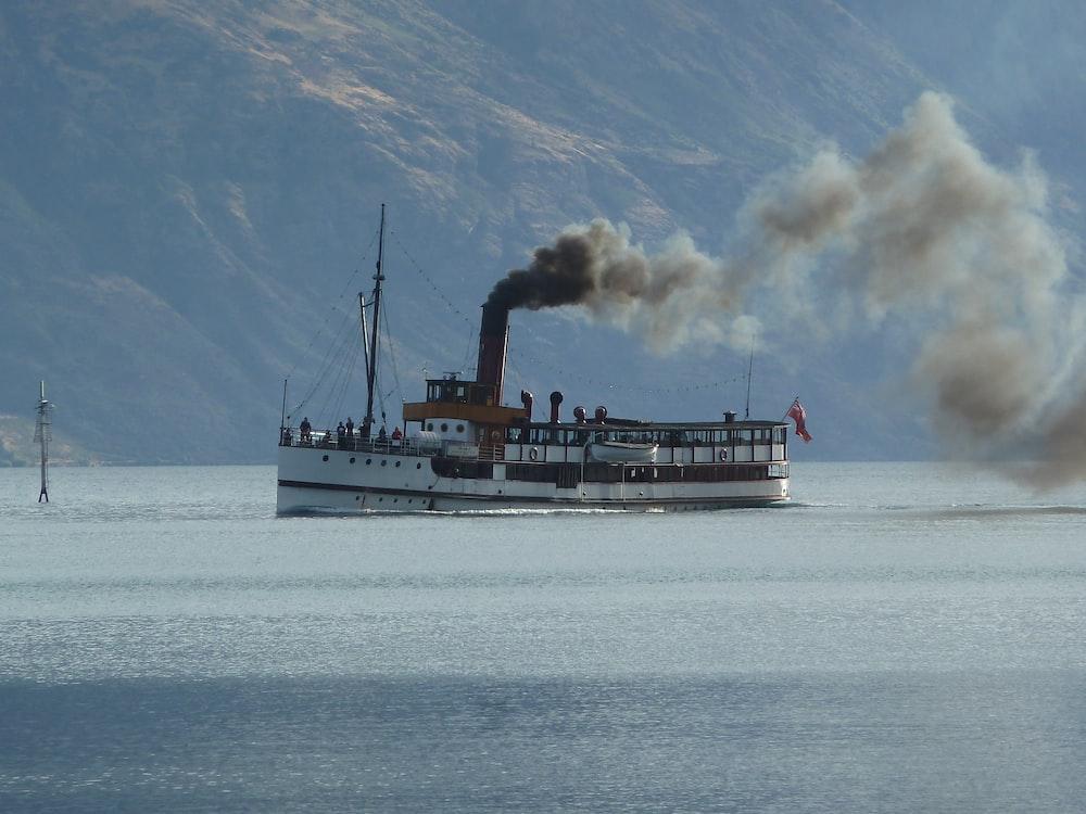 white ship on sea during daytime