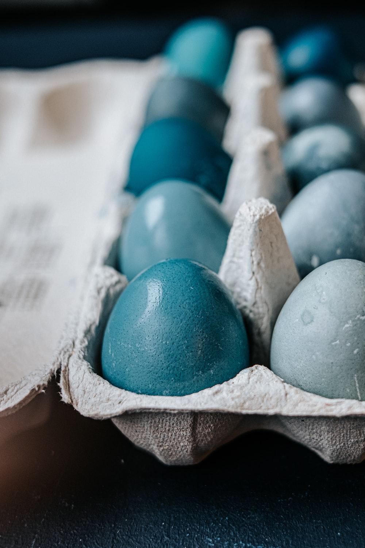 blue egg on brown paper bag