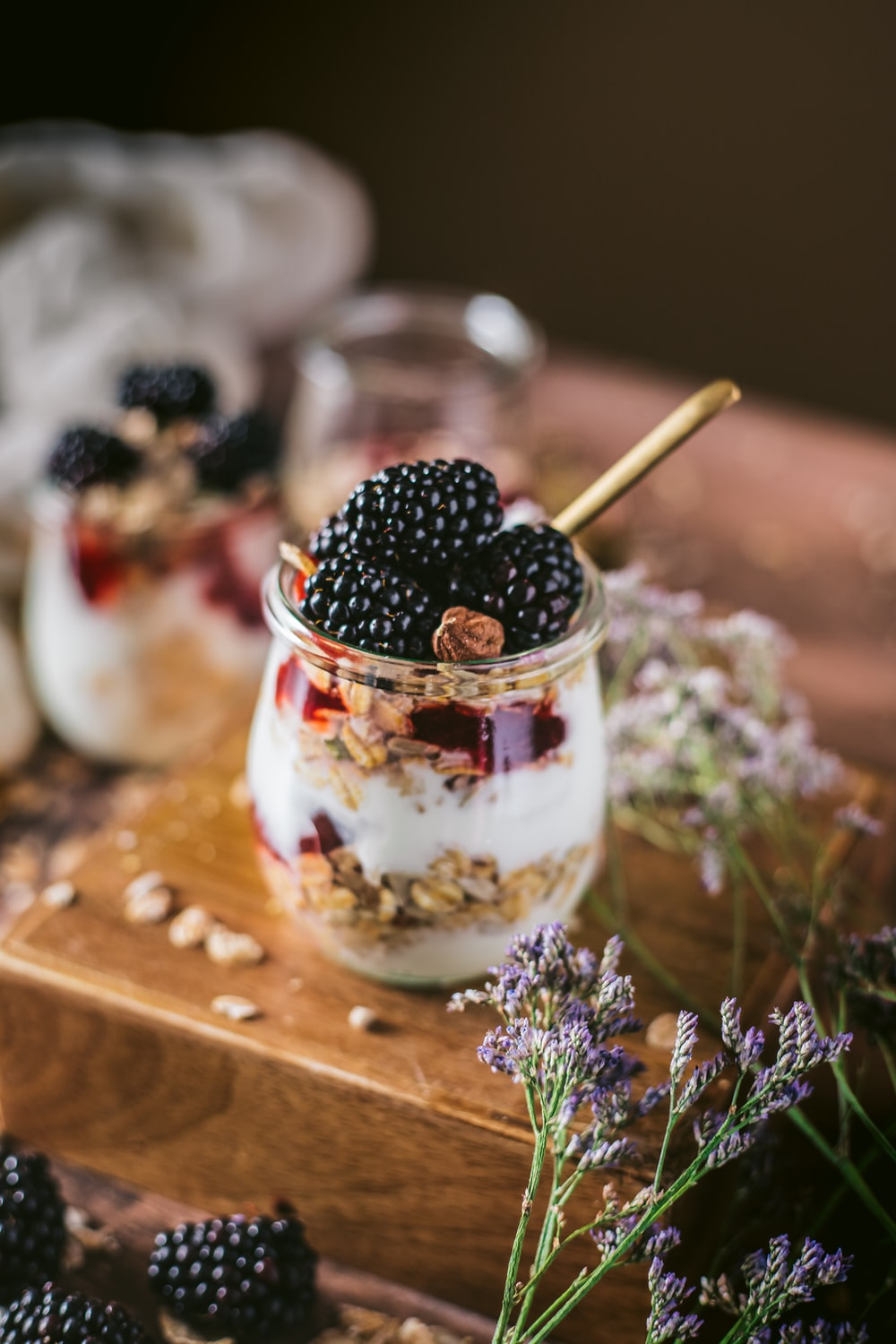 clear glass cup with black and red berries