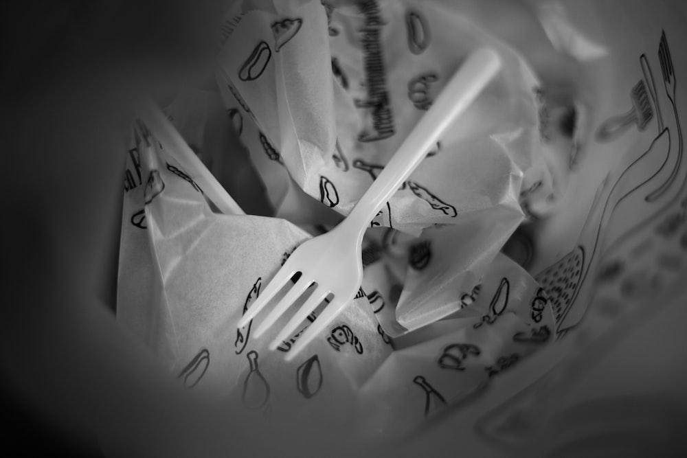 white plastic fork on white tissue paper
