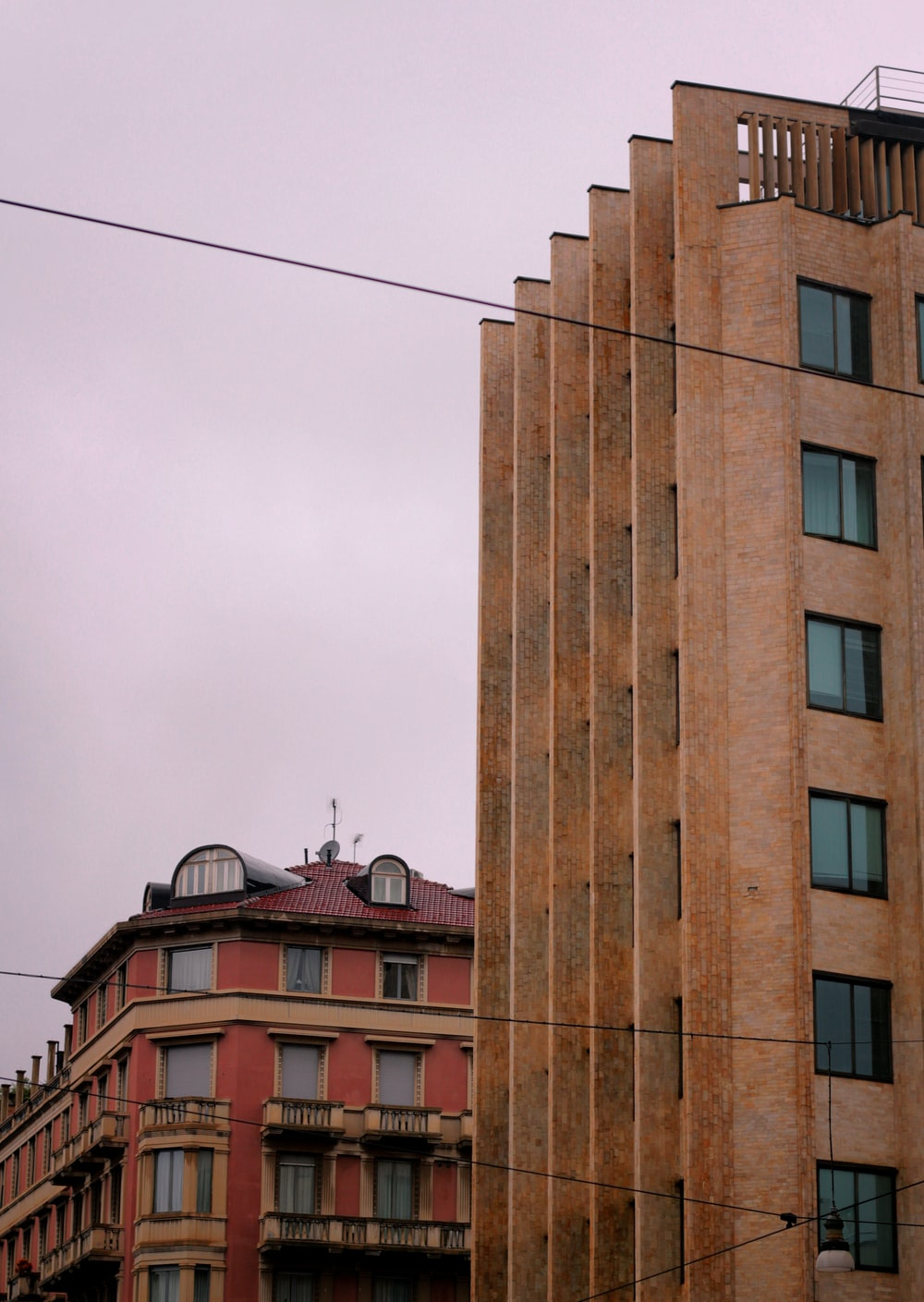 brown concrete building under white sky during daytime