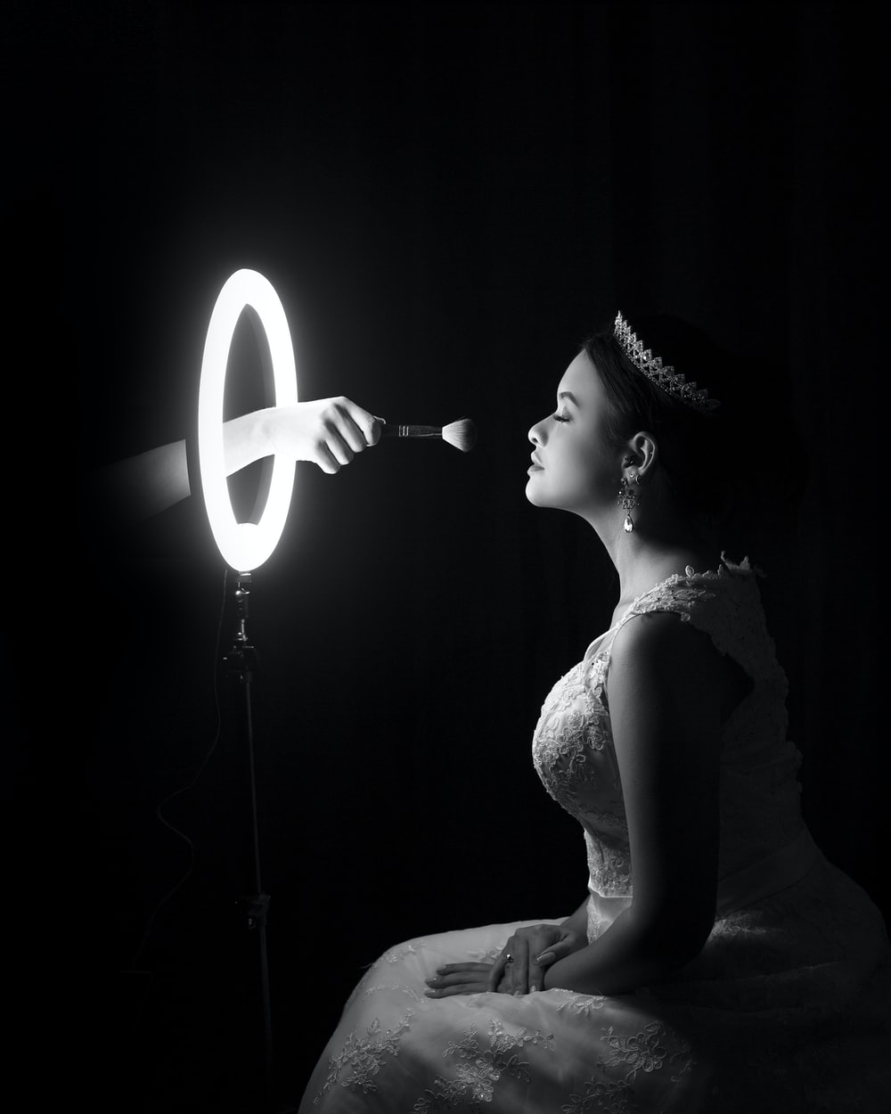 woman in white dress holding white light