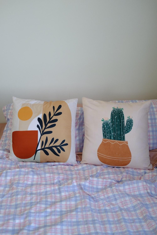 white and orange floral throw pillow