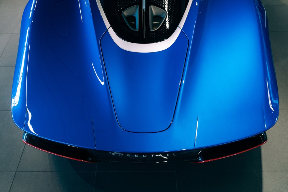 blue car with black and white door