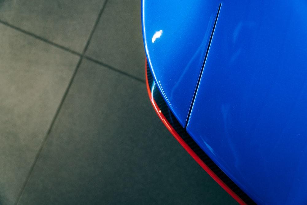 blue car on gray floor tiles